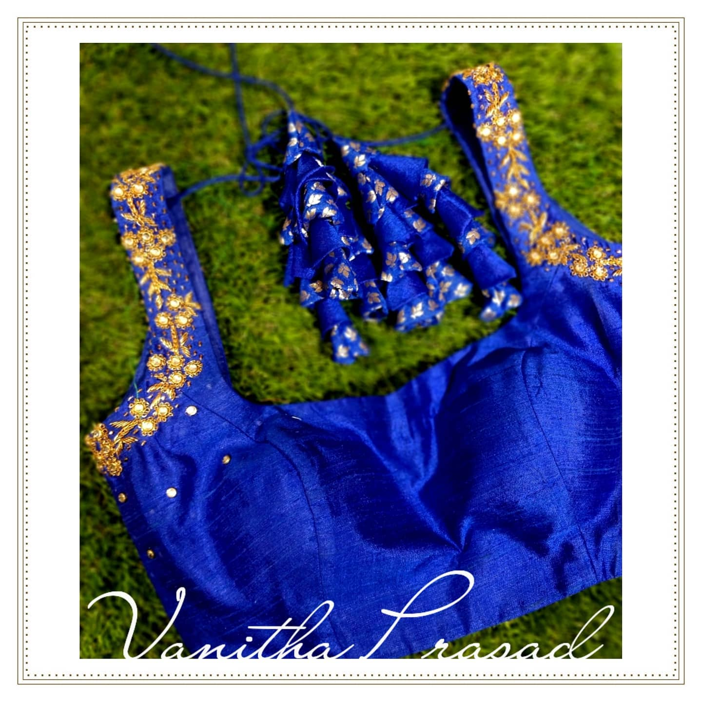 Smitten totally! Stunning royal blue color sleeveless blouse with hand embroidery mirror work and fabric tassels.   2021-08-05