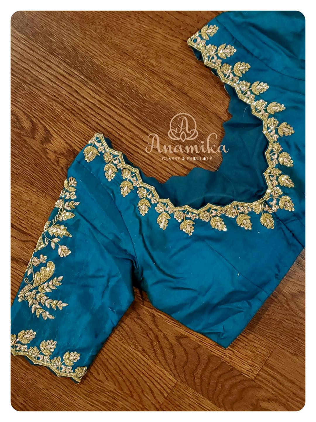 Stunning powder blue color blouse with zardosi work on neckline and sleeve. 2021-08-05