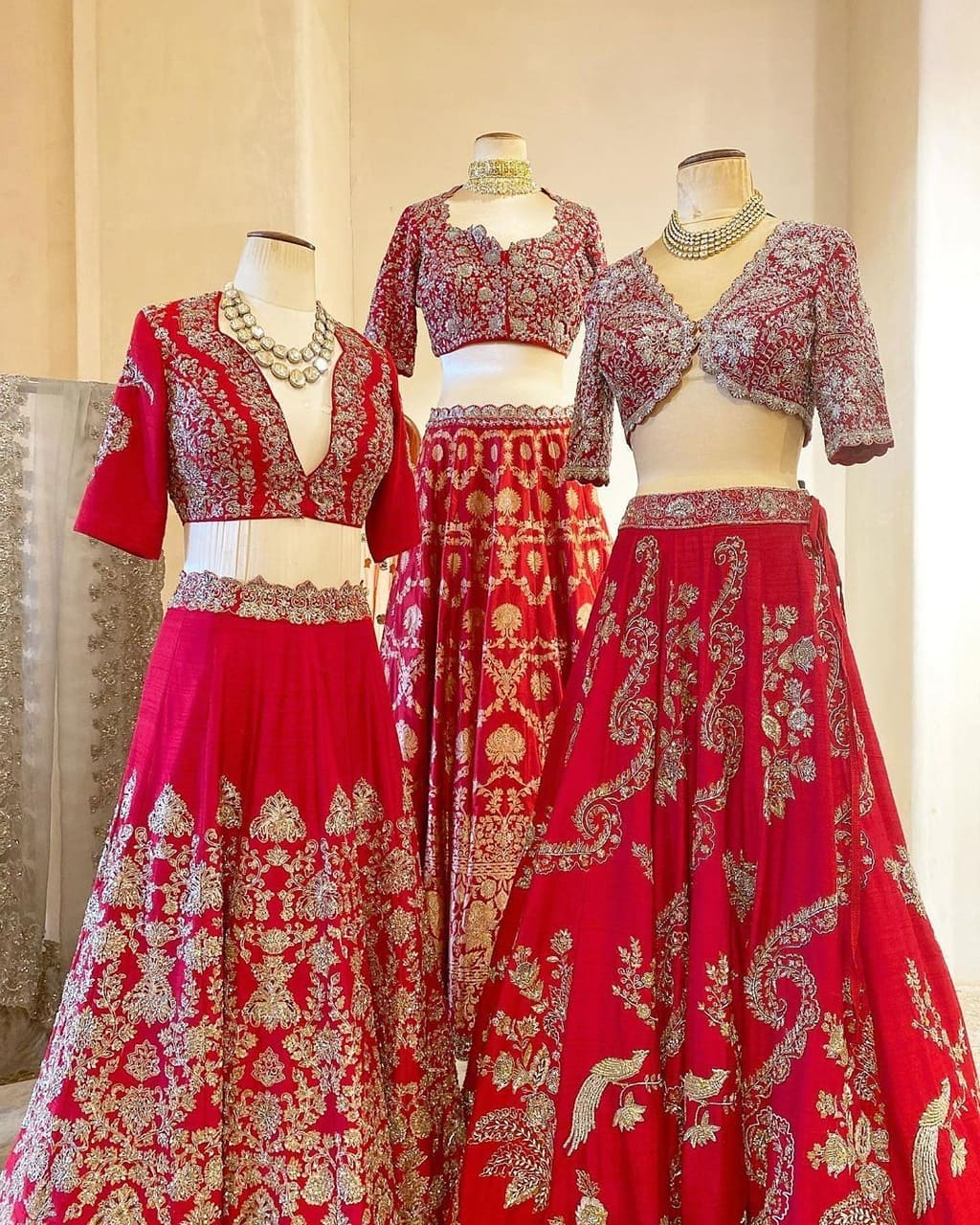 Stunning red bridal lehenga and blouse with signature silver thread hand embroidery work.  2021-08-05