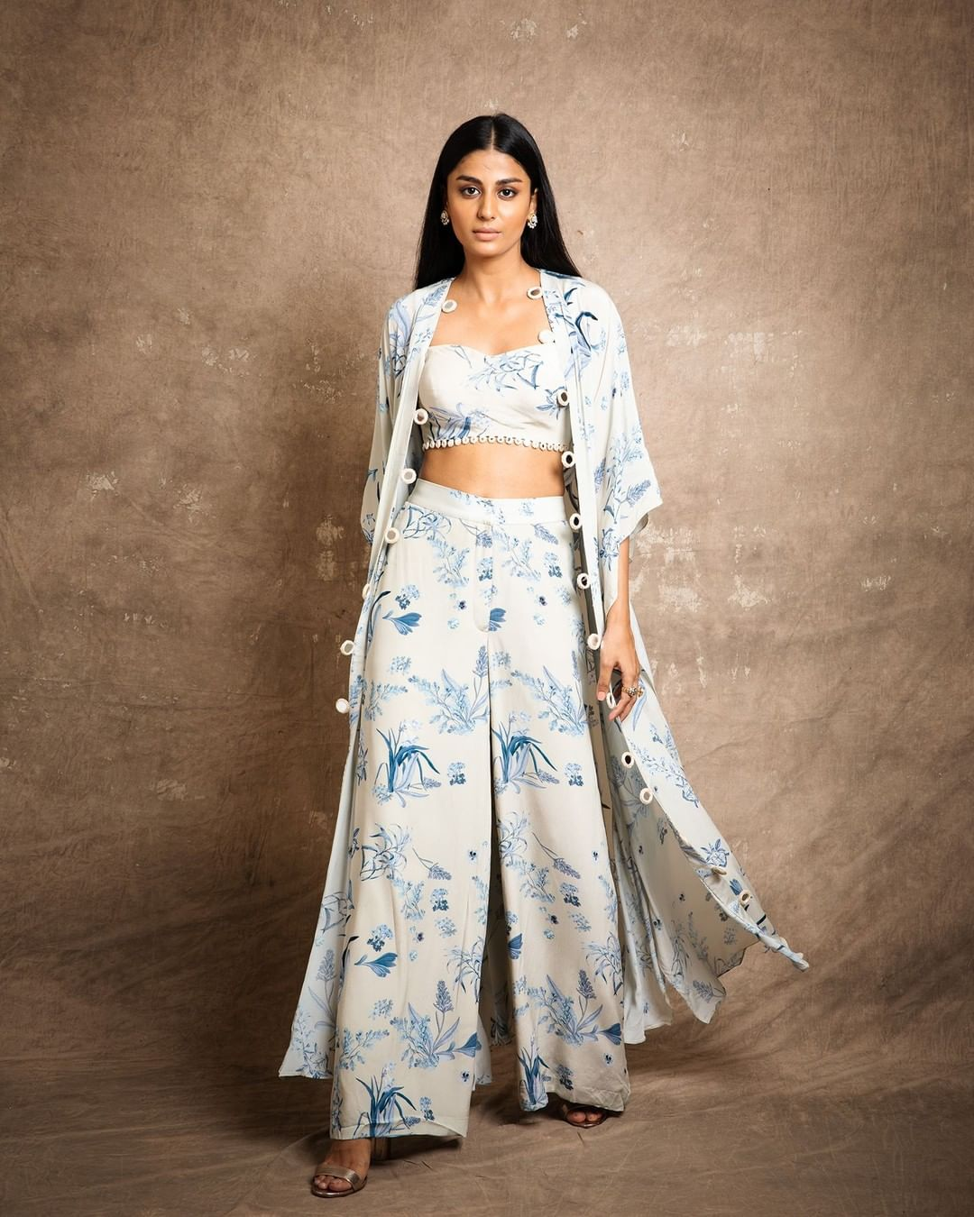 Inspired by the calmness and spirit of blue sea  enjoy a breezy affair in Seashore floral print pant blouse and cape set with mirror detailing.  For further enquiries please connect with  team on +91 7506633202 via call or WhatsApp. 2021-08-05