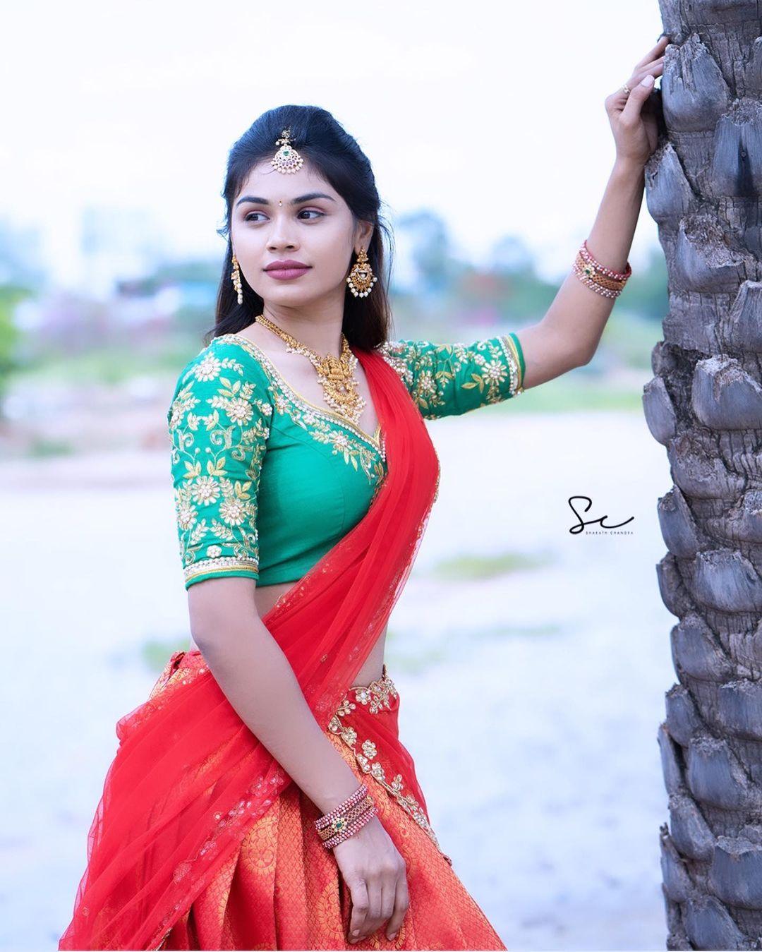 Beautiful actress Anchor Bhanu in red pattu lanaga voni. Outfit :  Firoz design studio. 2021-08-05
