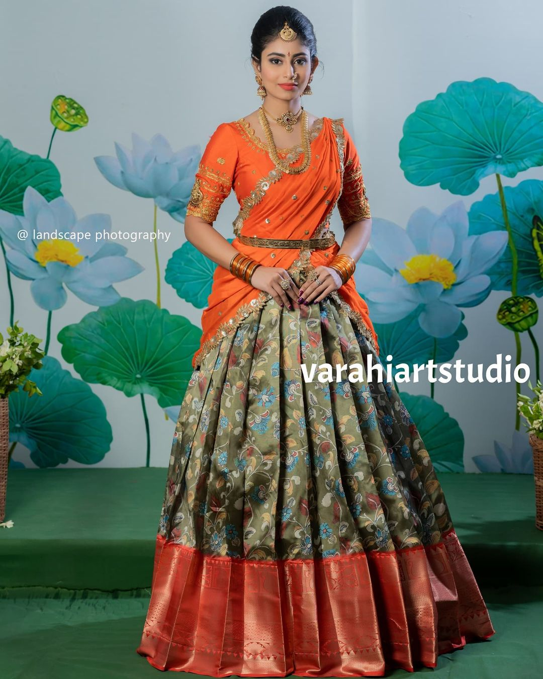Gorgeous olive green floral big border pattu lehenga and orange blouse with dupatta. Blouse with hand embroidery work.  2021-08-05