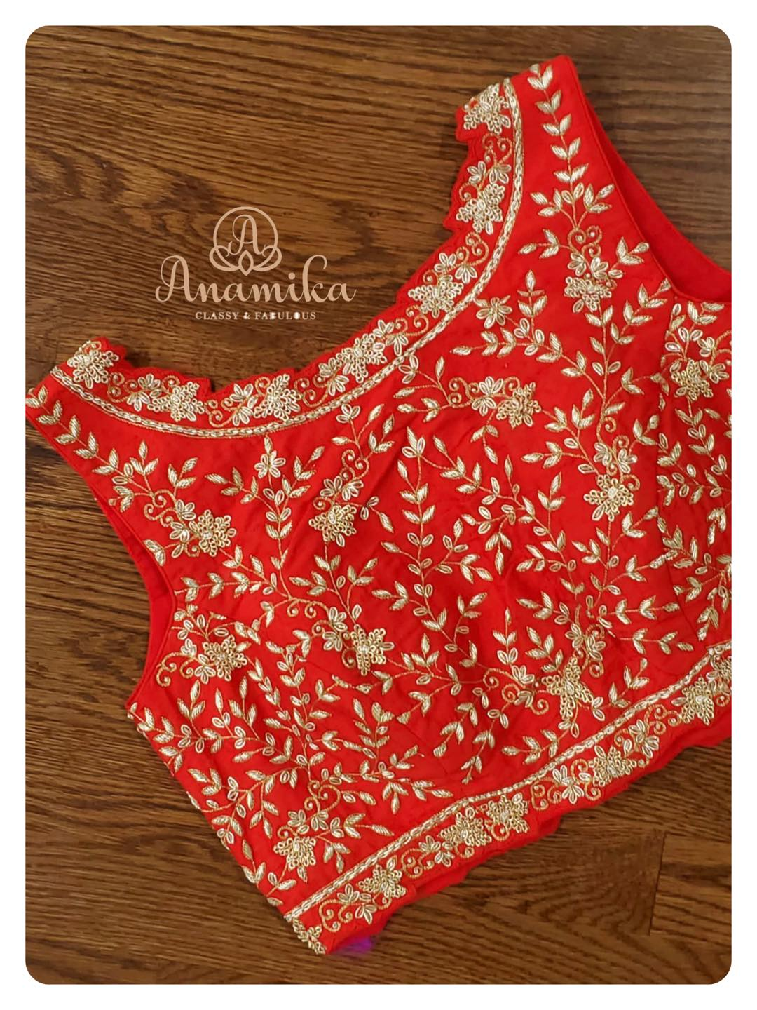 Stunning red color sleeveless bridal blouse with leaf creeper hand embroidery maggam work.  2021-08-06