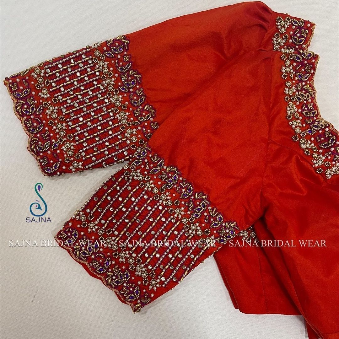 Gorgeous red color bridal blouse with bead and stone aari work on neckline and sleeves. 2021-08-06