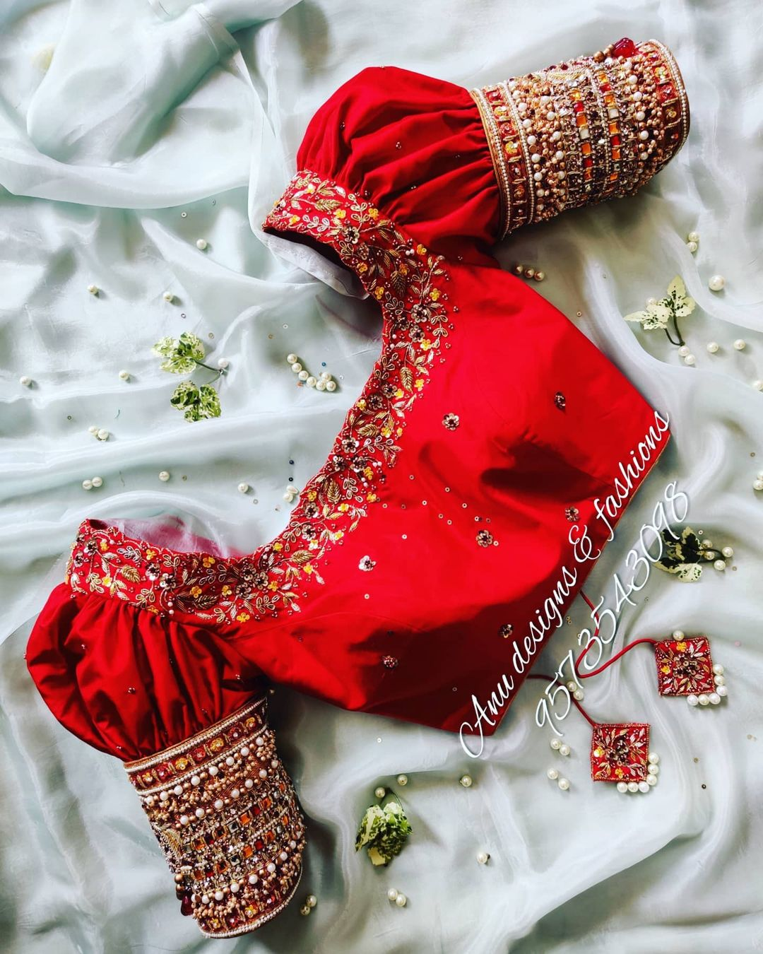 Stunning red color bridal blouse with  floral creeper stone and bead heavy maggam work. 2021-08-06