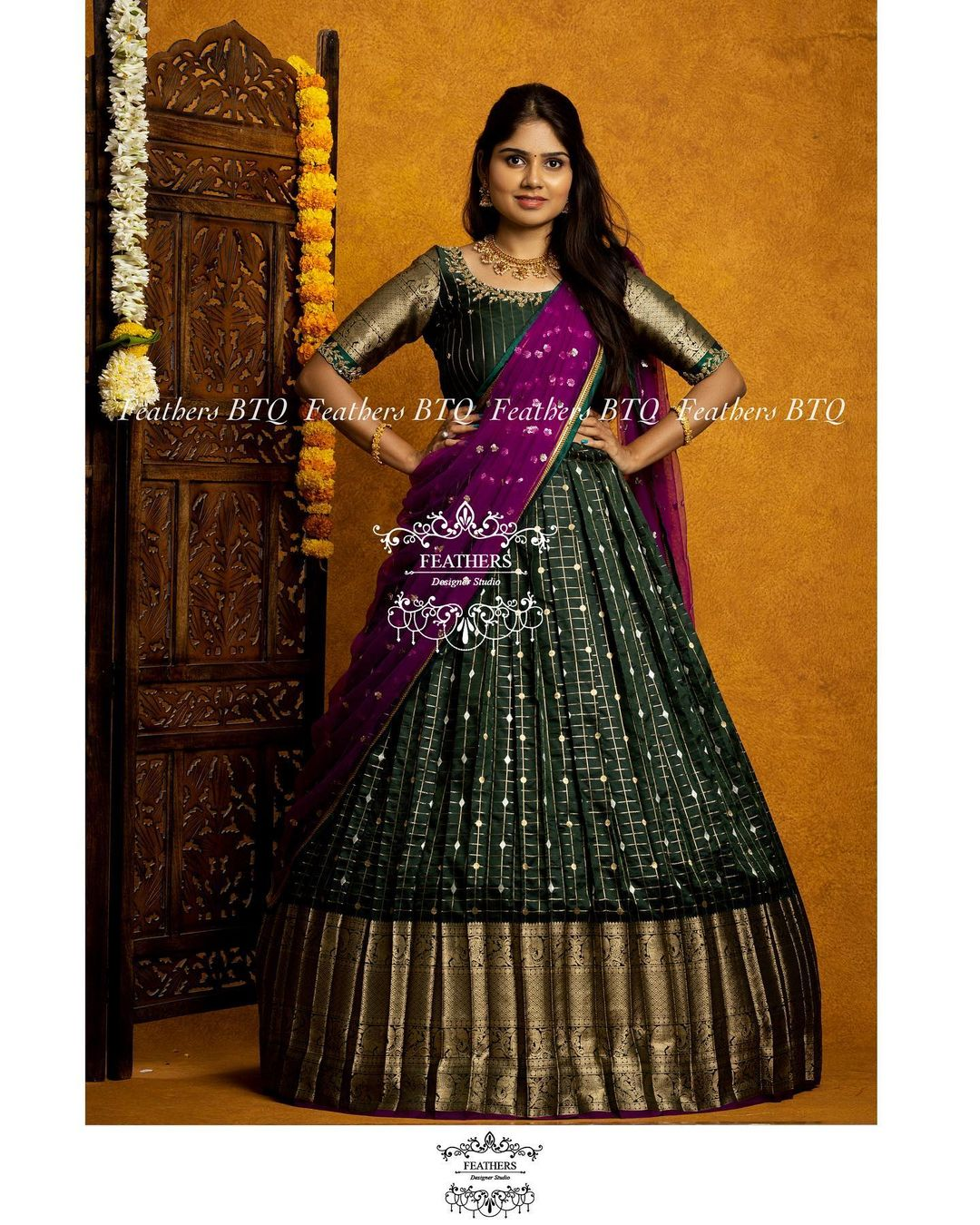 Stunning leaf green color pattu lehenga and blouse with purple color net dupatta. Blouse with gold jari sleeves. 2021-08-06