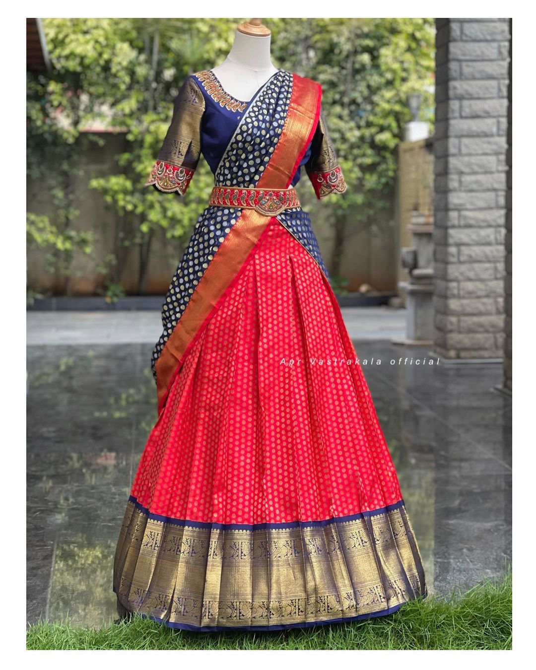 Gorgeous red and navy blue color combination pattu langa voni. Traditional halfsaree. Blouse with ahdn embroiderywork and embroidery waist belt.   2021-08-06