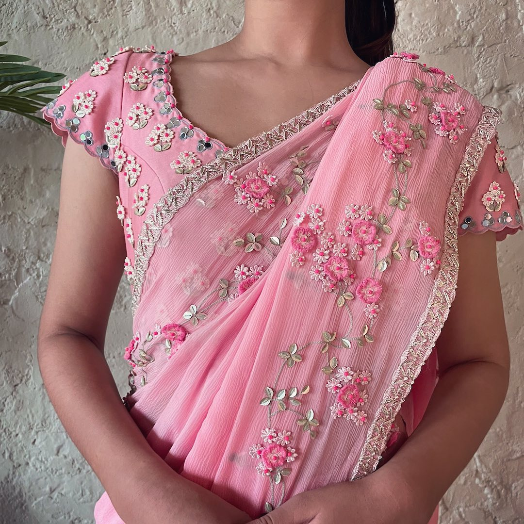 Gorgeous blush pink color designer saree and blouse with classy floral hand embroidery work all over.  2021-08-07