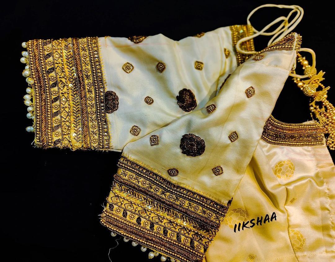 Gorgeous off white color bridal blouse with bead aari work on neckline and sleeves.  2021-08-08