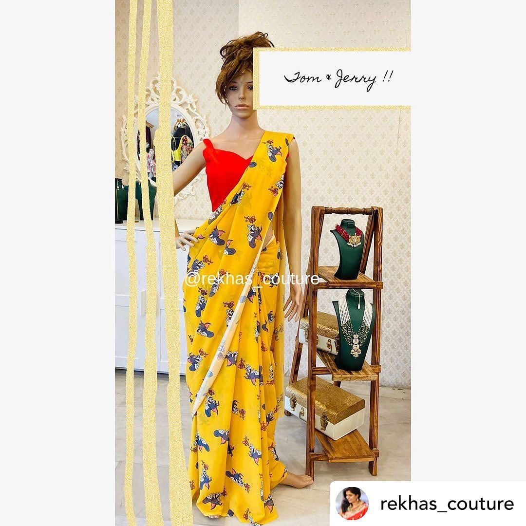 Gorgeous yellow color Tom and Jerry print designer saree and red blouse. 2021-08-10