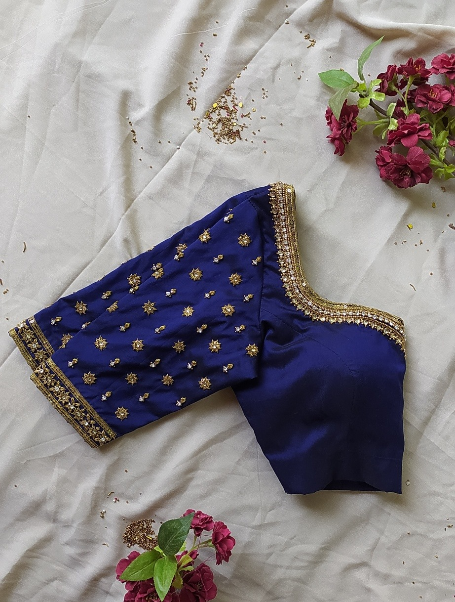 Hand Embroidered blouses! Stunning navy blue color bridal blouse with bead and stone aari work on neckline and sleeves. 2021-08-10