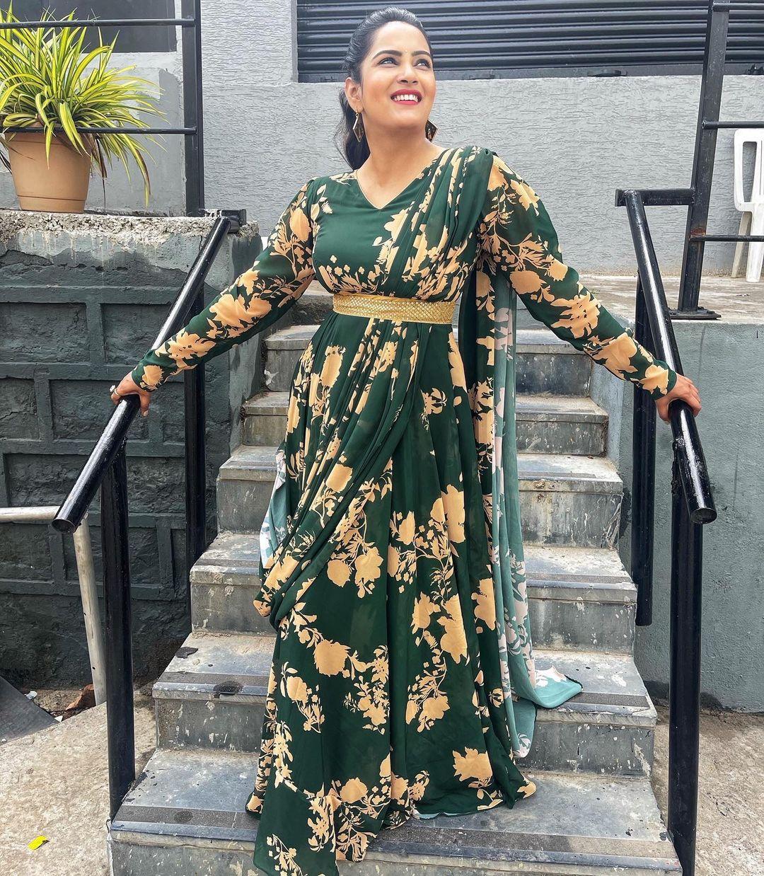 Beautiful actress Himaja in bottle green floor length floral long frock with waist belt. 2021-08-12