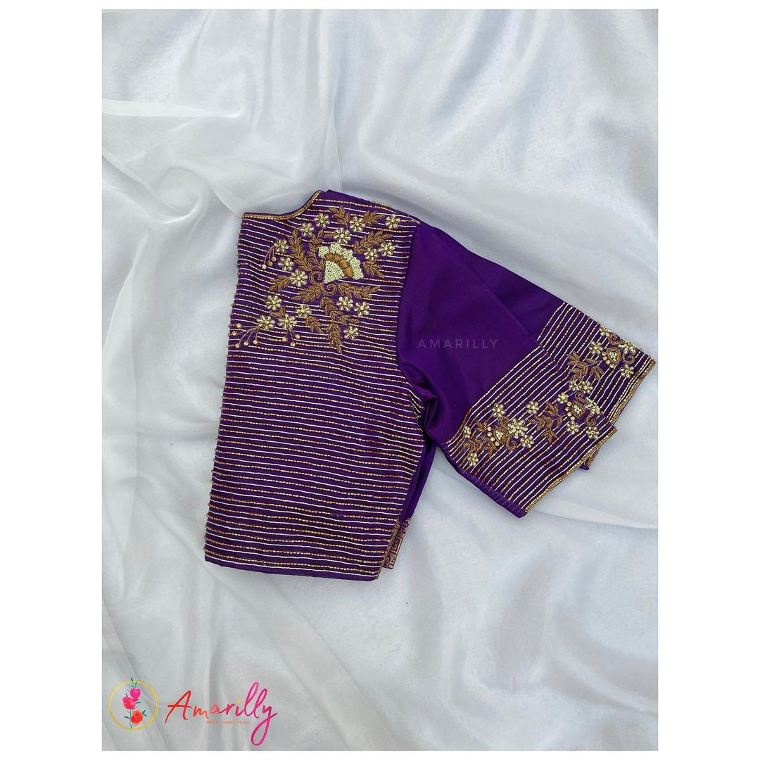 Gorgeous purple color blouse with flora gold thread and stone aari work allover. 2021-08-12