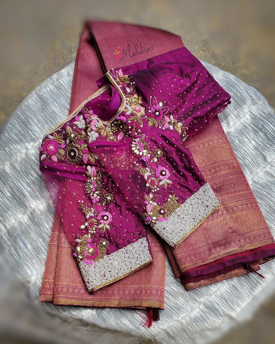 Gorgeous purple color bridal blouse sree back and cold shoulder. Blouse with floral hand embroidery maggam work.  2021-08-14
