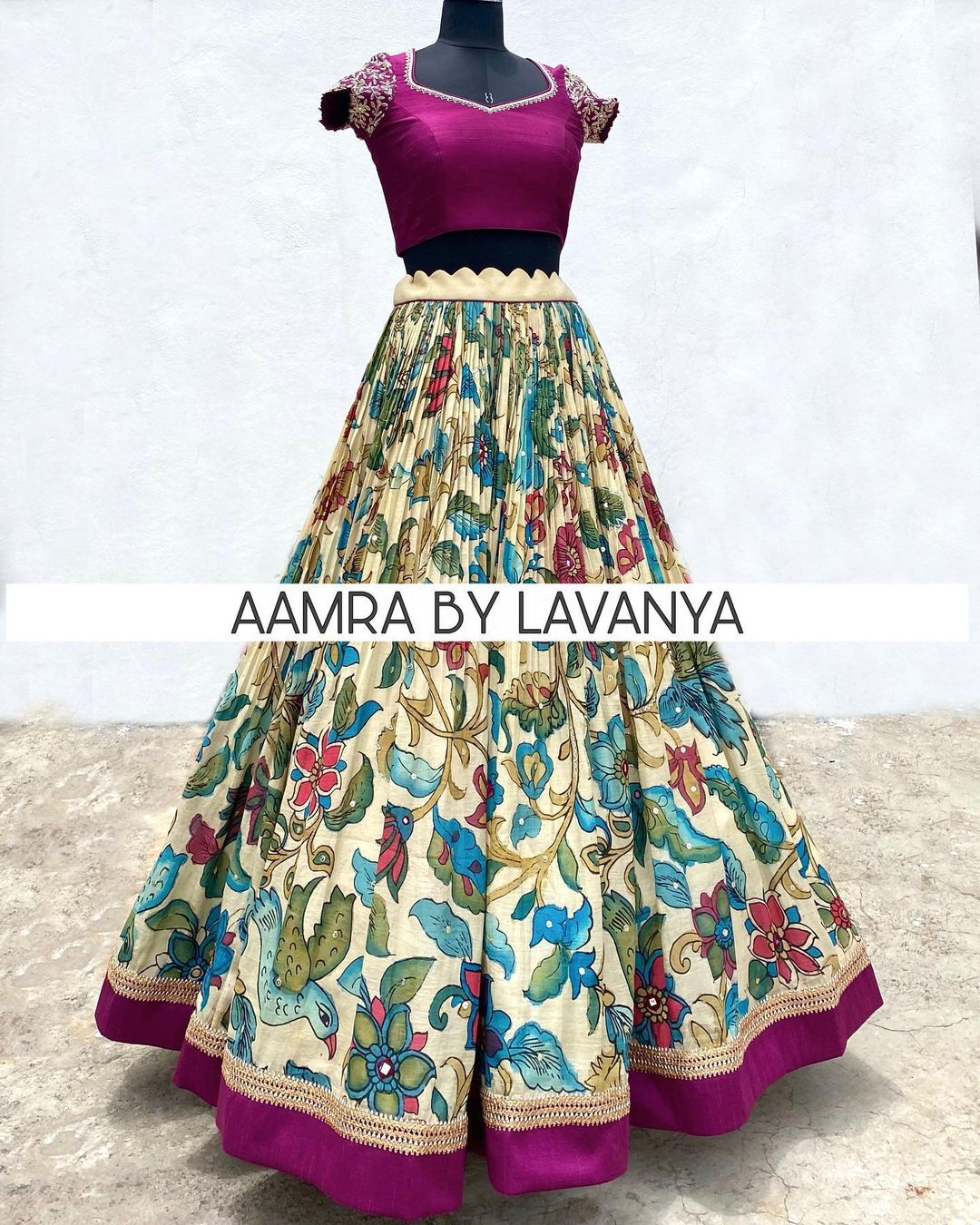 Hand painted and hand embroidered pen kalamkari silk lehenga paired with a hand embroidered croptop & dupatta. For orders and queries call/whatsapp on +91-9177363970. 2021-08-16