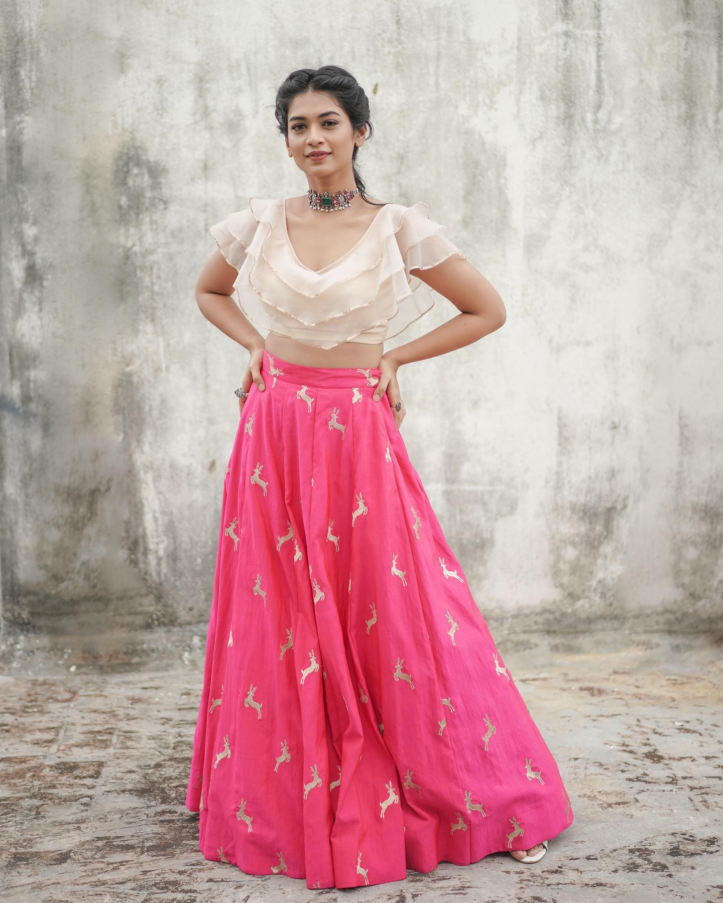 Organza ruffle top and deer embellished rawsilk lehenga!  Styled with statement piece from Prade jewels . 2021-08-17