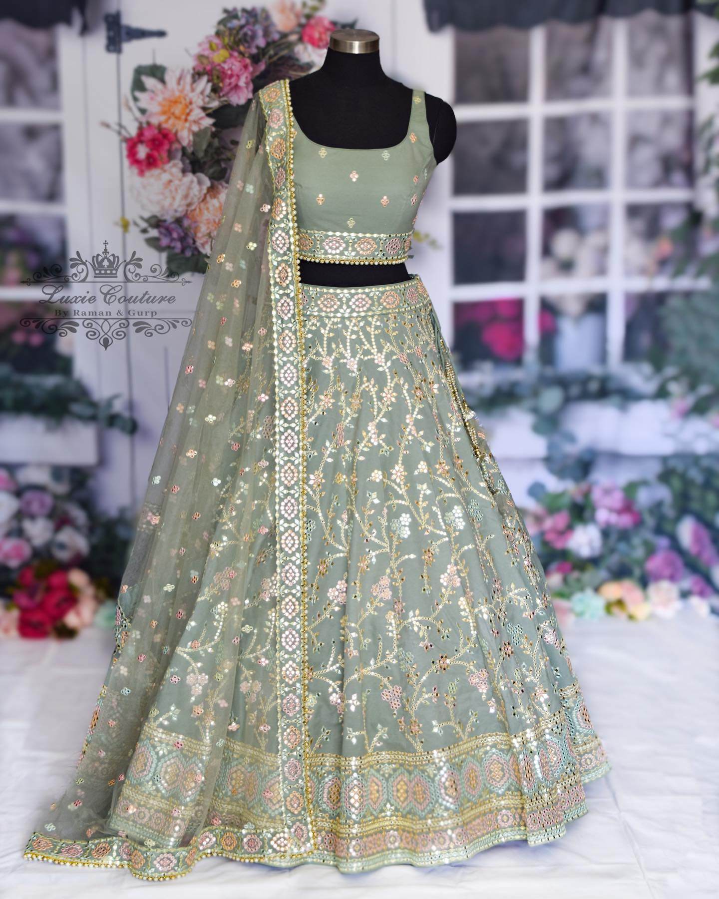 Gorgeous gray color bridal lehenga and blouse with net dupatta. Lehenga set with hand embroidery work.  2021-08-18