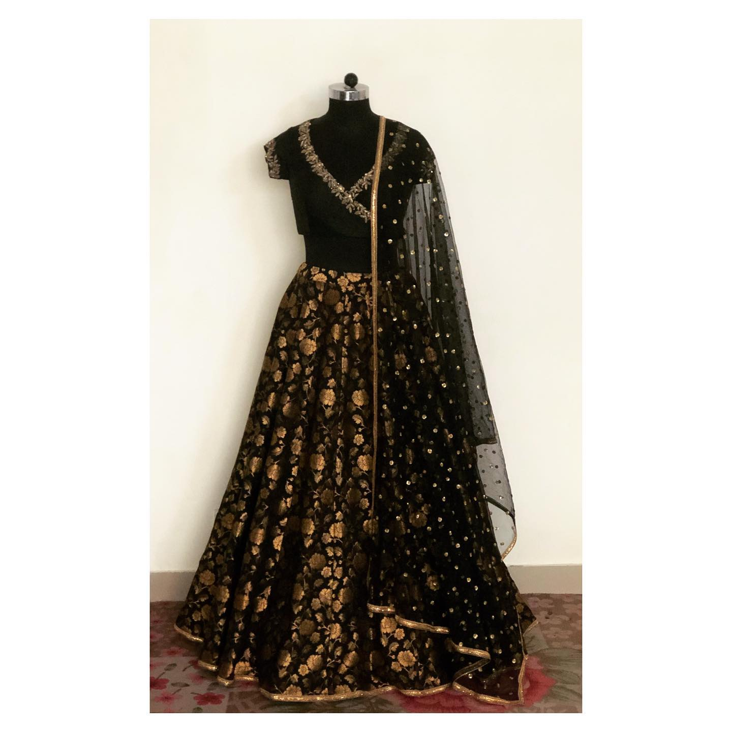 Customised this beautiful black and gold brocade lehenga with hand embroidered over-lapped blouse . To order/customise DM or WhatsApp at +918527463626 or Email: shivani@intricado.com. 2021-08-20