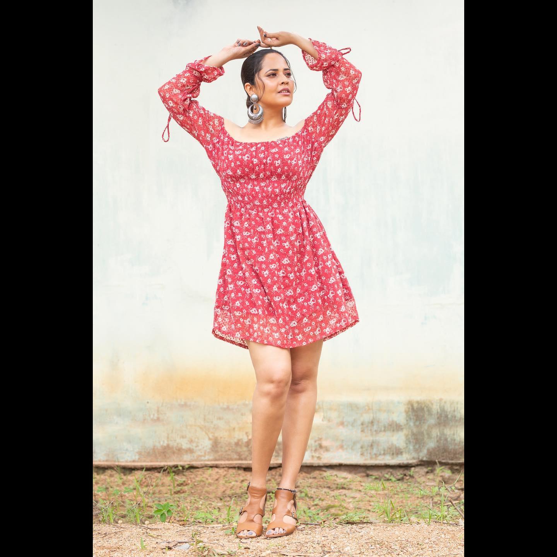 Beautiful actress Anasuya Bardwaj in off shoulder knee length dress for jabardasth. 2021-08-20