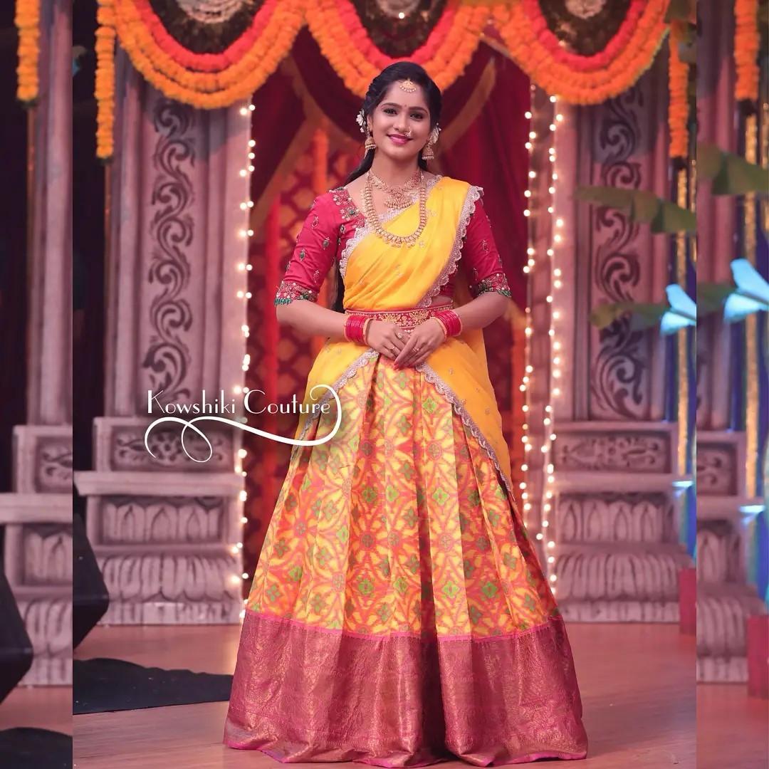 Gorgeous Actress Tejashwini Gowda in beautiful half saree adorned with emerald jewelled blouse.