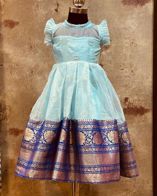 Stunning ice blue color kids frock with big pattu boarder. Price starts from 4500 INR. To order WhatsApp 7013728388. 2021-08-25