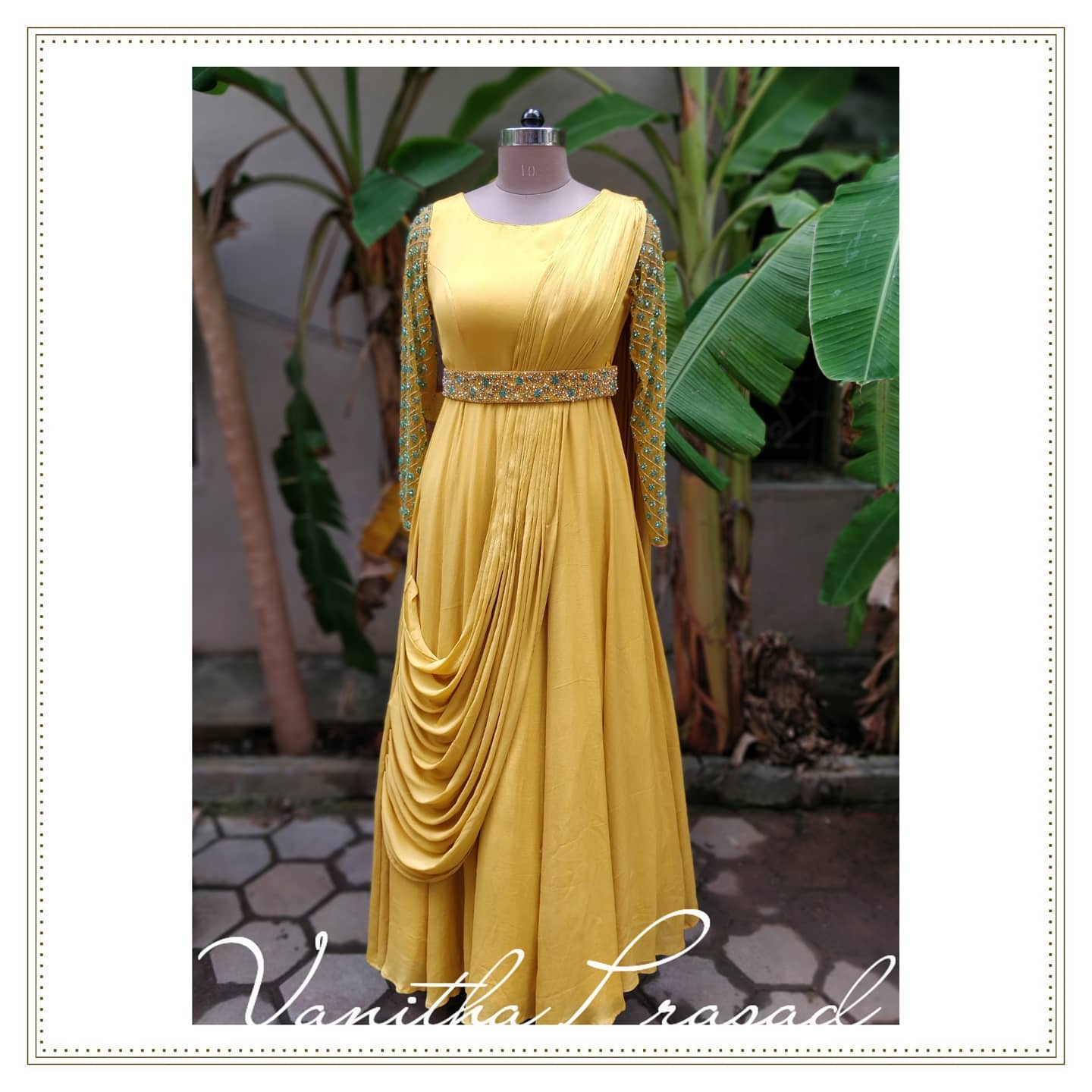 This season it's raining drape dresses in Vanitha couture studio. Beautiful yellow color pre draped floor length dress with embroidery waist belt.  2021-08-26