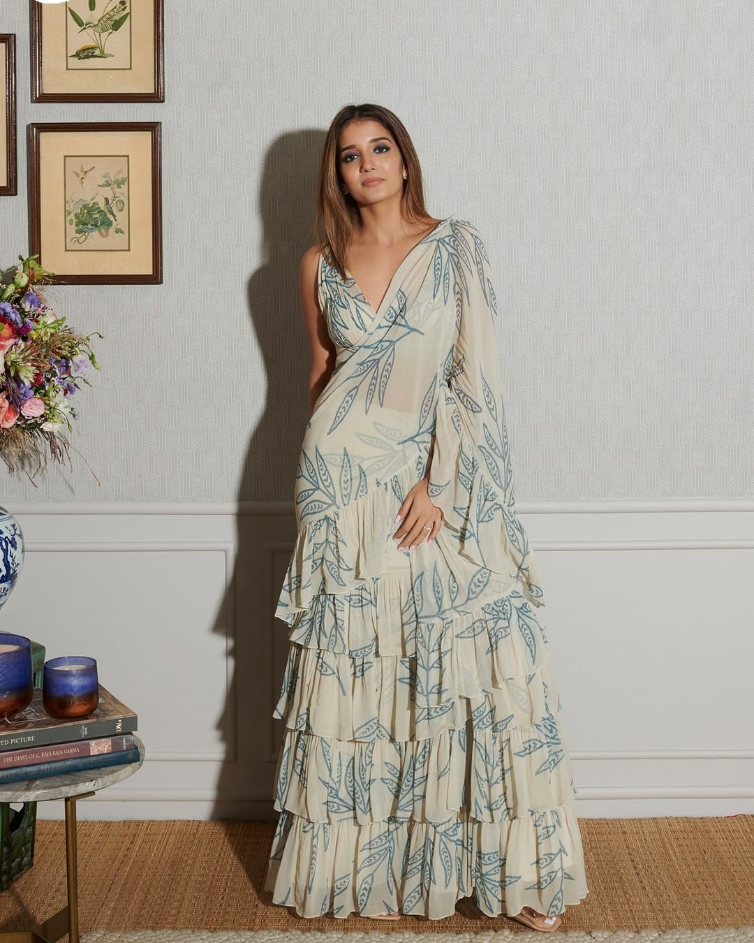 Keeping it classy yet effortless as seen in the frame Arpita Mehta in her own Seashore leaf printed ruffle sari paired with the same print pleated blouse.  For further enquiries please connect with team on +91 7506633202 via call or WhatsApp. 2021-08-26