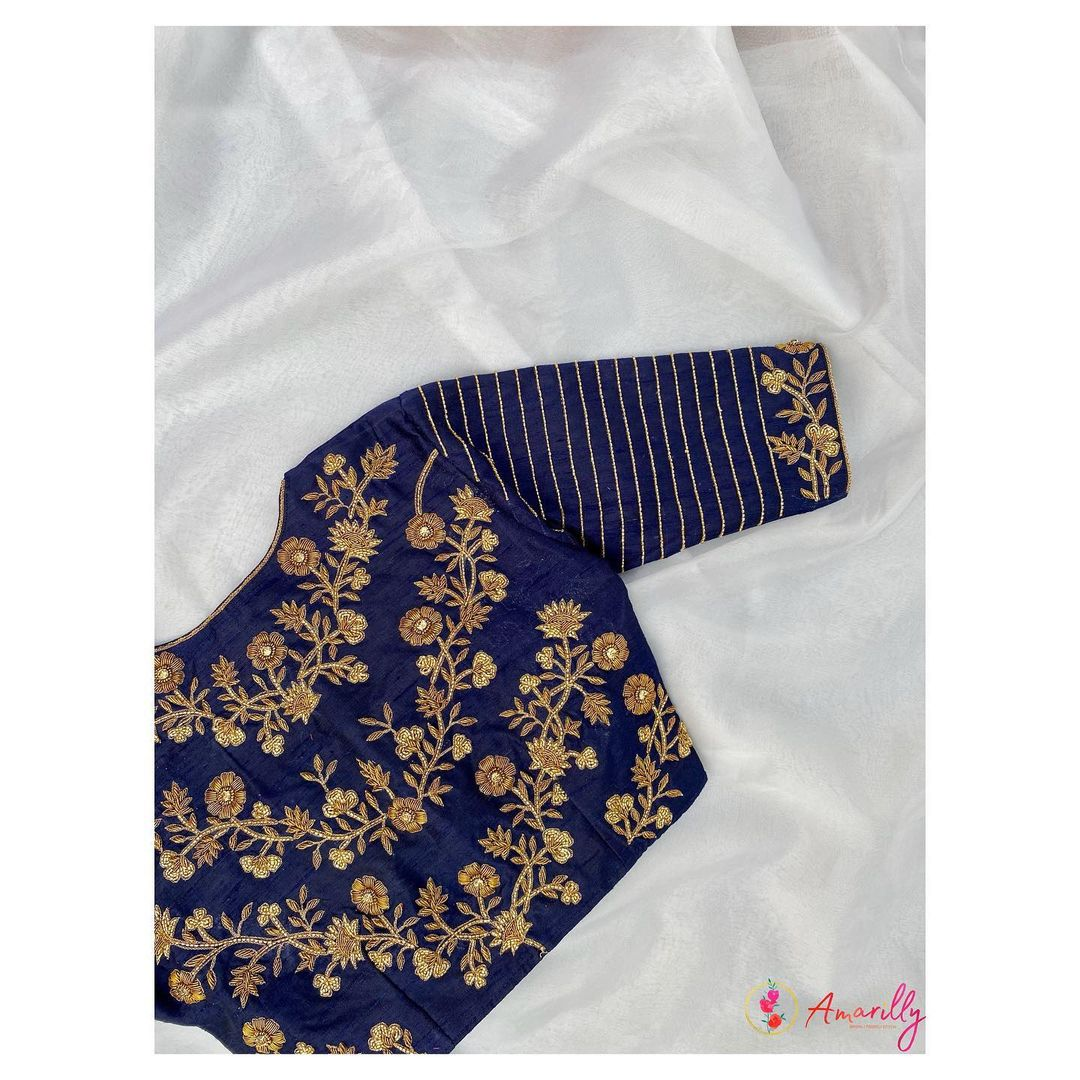 Stunning navy blue color high neck blouse with floral and creeper gold thread and bead maggam work. 2021-08-27