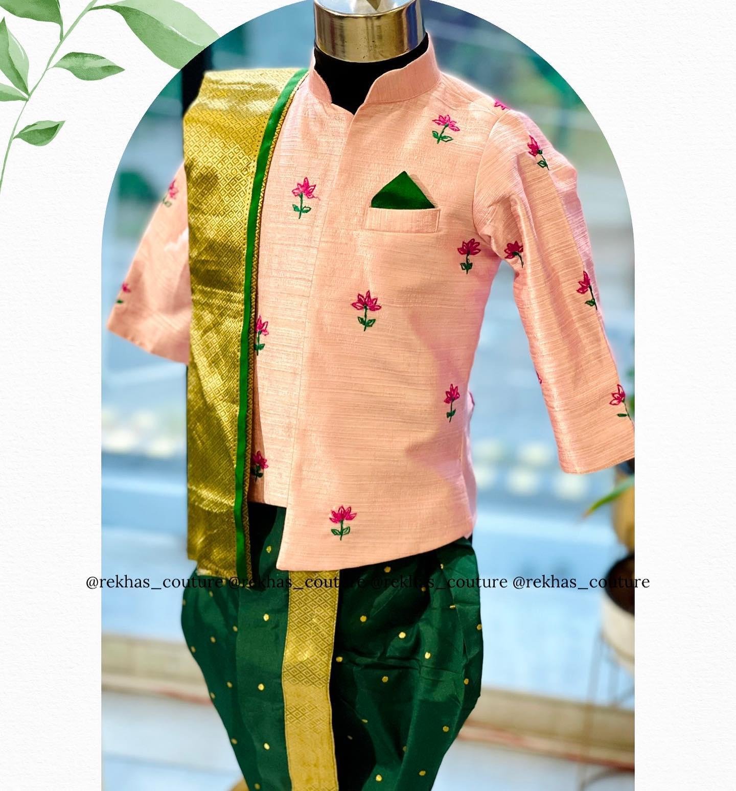 Stunning blush pink color kids sherwani with green pattu dhoti. 2021-08-28