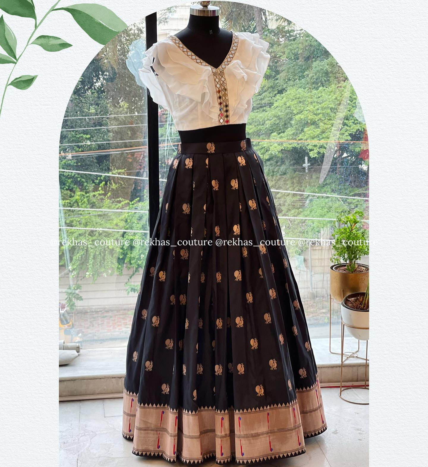 Gorgeous black color pattu skirt and pearl white color crop top. Crop top with mirror work. 2021-08-28