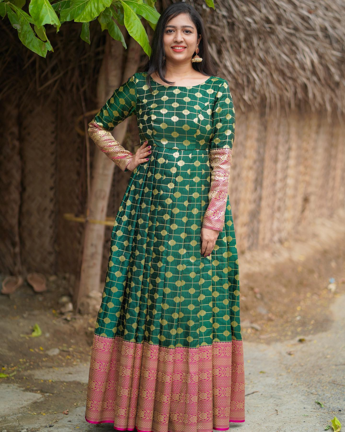 Stunning bottle green color pattu long frock with big border and full pattu sleeves. 2021-08-28