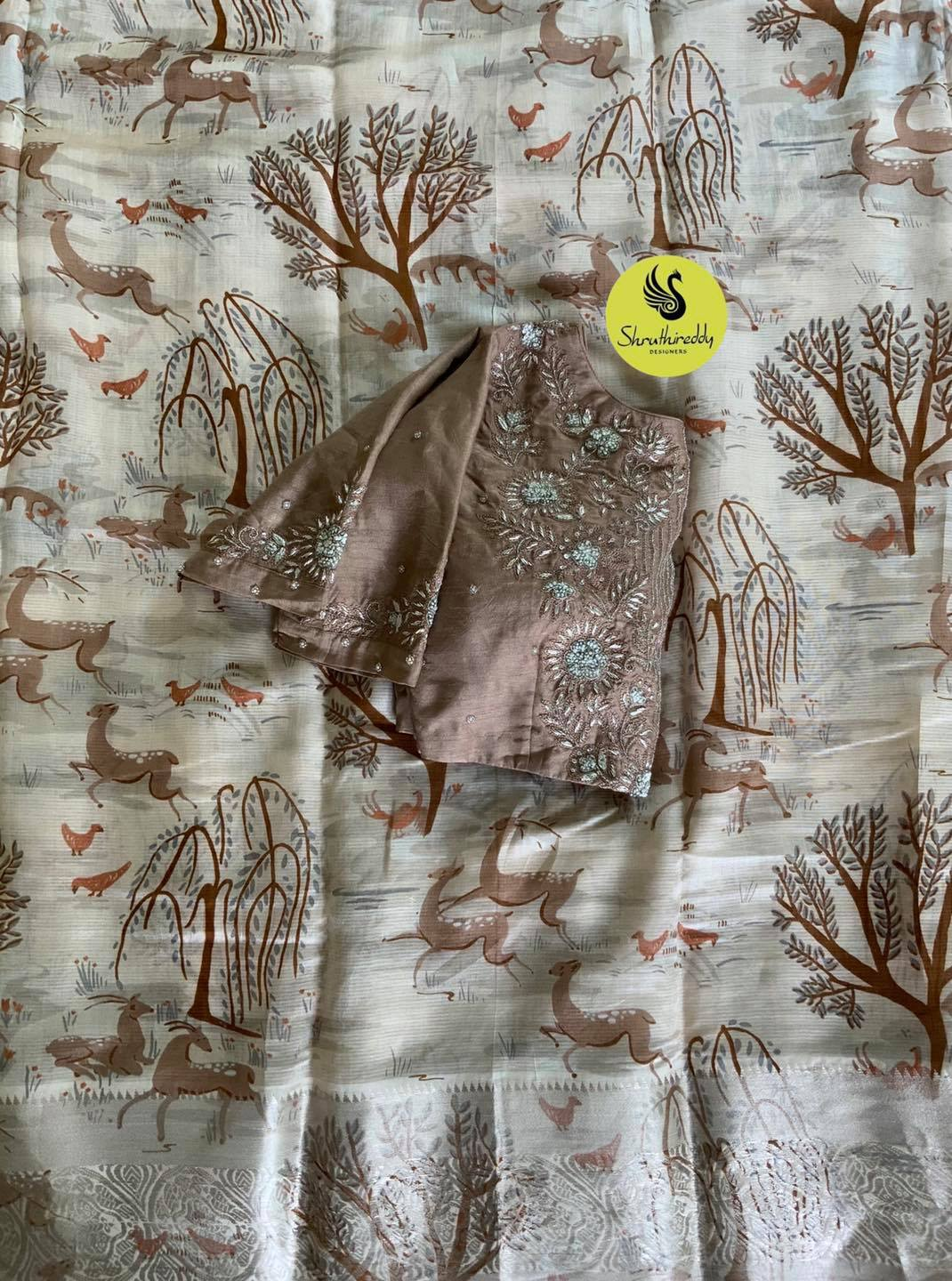 Gorgeous forest print designer saree and gray color blouse with floral hand embroidery maggam work.  2021-08-28