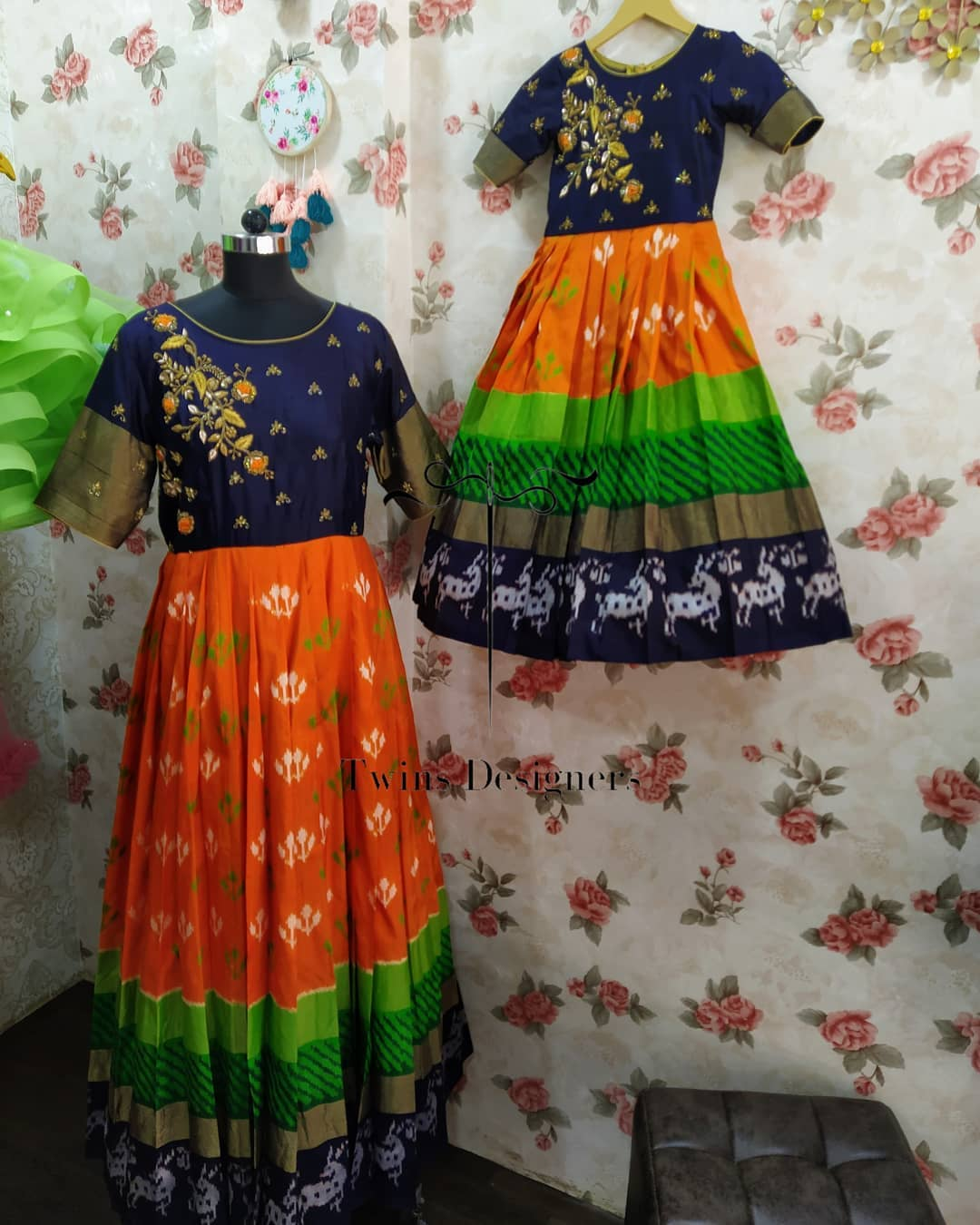 Beautiful ikkat Mom and daughter long frock with hand embroidery work on yoke.    2021-08-28