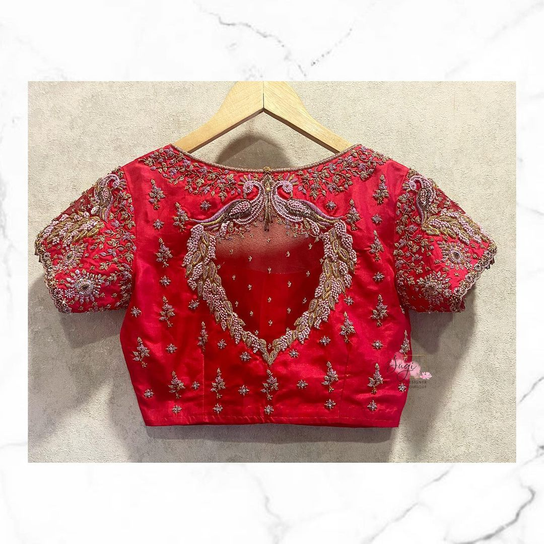 Stunning red color boat neck blouse with peacock hand embroidery aari work.  2021-08-28