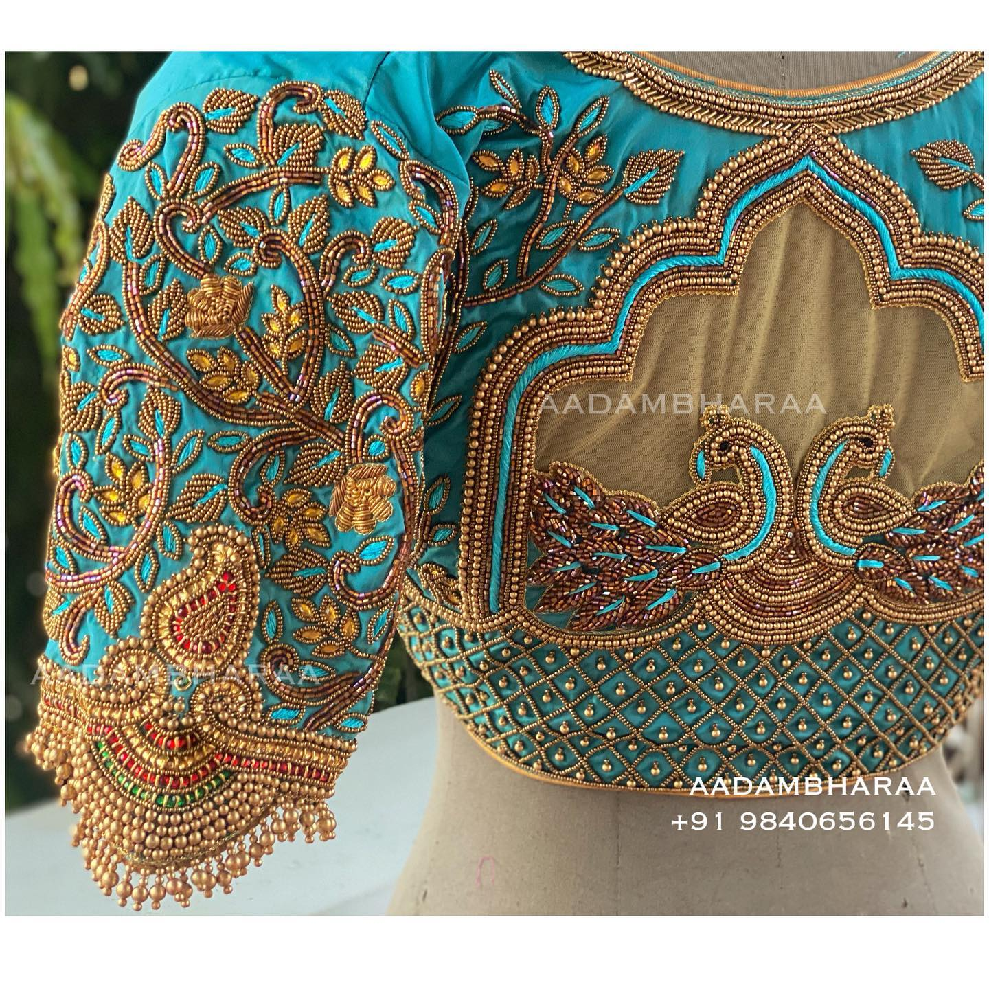Shades of Blue. Stunning powder blue color blouse with peacock and floral bead aari work. 2021-08-29