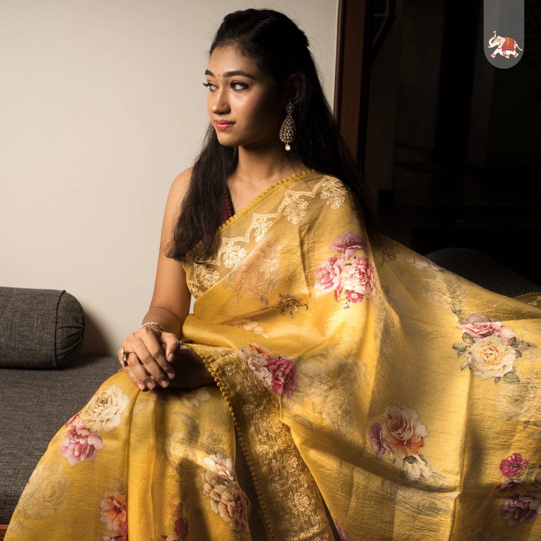 Beautiful floral printed mustard organza saree with thread work embroidered border and pallu is paired with ready made maroon sleeveless designer blouse for a very fancy look! 2021-08-29