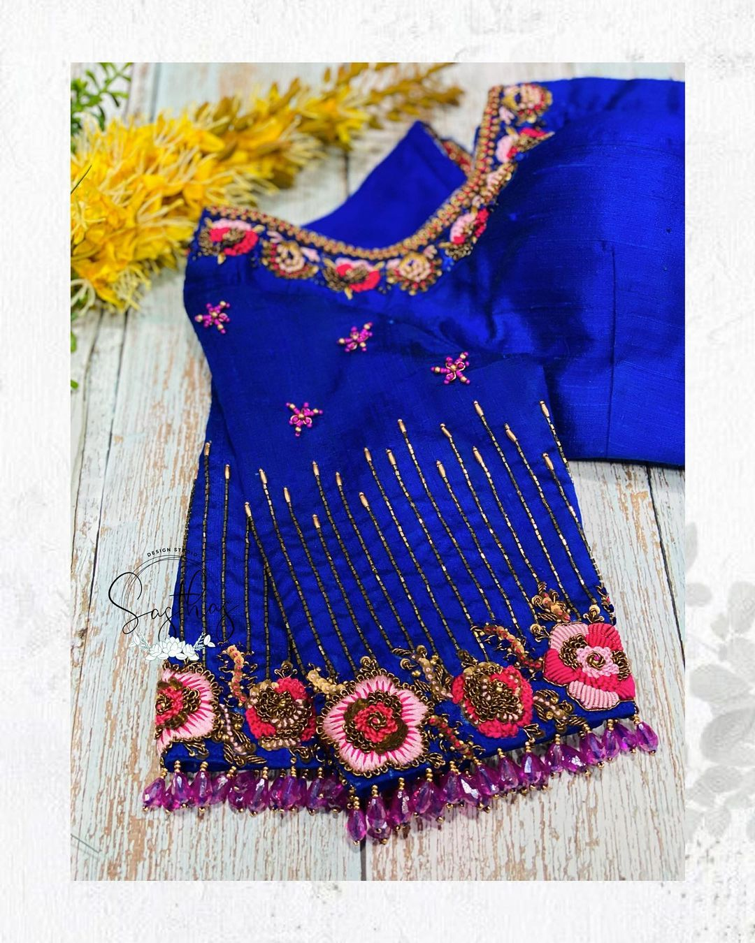 Stunning blue color bridal blouse with floral thread work on sleeves and neckline. 2021-08-29