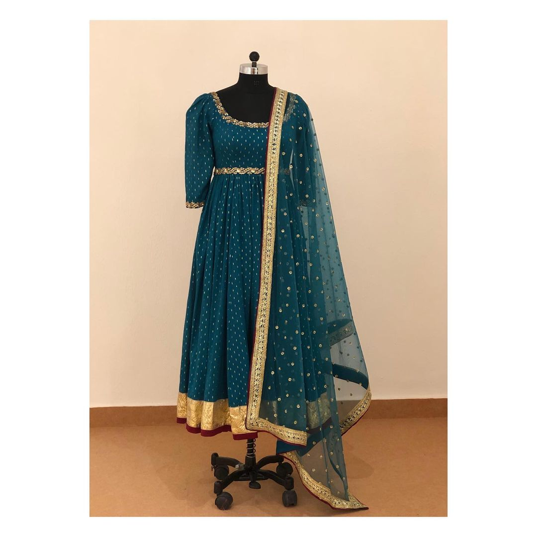 Peacock blue puffed sleeves anarkali in pure chanderi brocade with kundan work around neck and sleeves and detachable belt. 2021-08-30