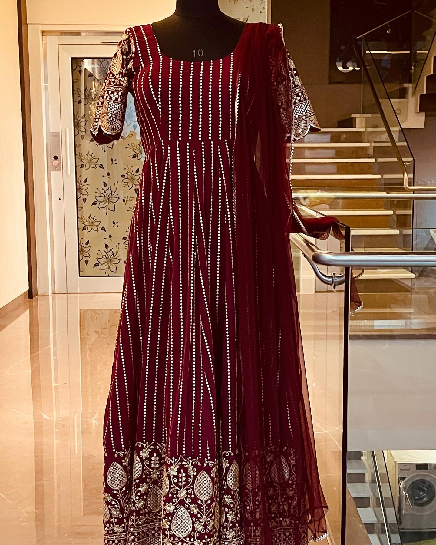 Stunning maroon color faux georgette floor length long  frock with hand embroidery stone work and net dupatta.  2021-08-31