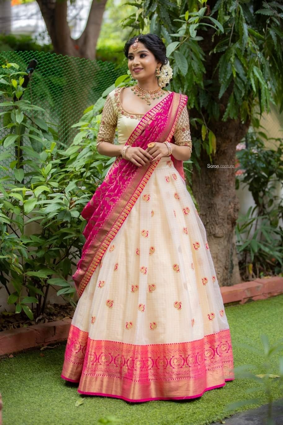 Off white and pink halfsaree. . . off white pleated skirt paired with Embroidered blouse and pink banarasi dupatta✨ Place your orders now!  . . For orders & queries please whatsapp  on  9952093562 or Reach  on 044 4262 4085. 2021-09-01