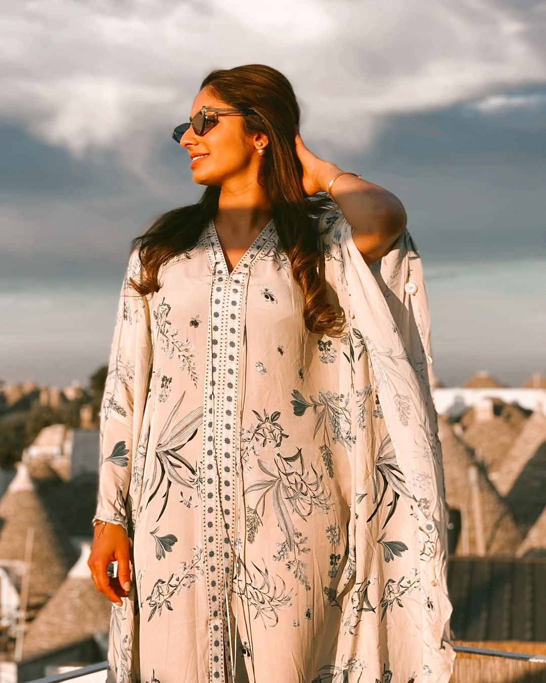 Seize the sunny day with AMWoman in Seashore floral print kaftan with cowrie shell and mirror detailing.  2021-09-01