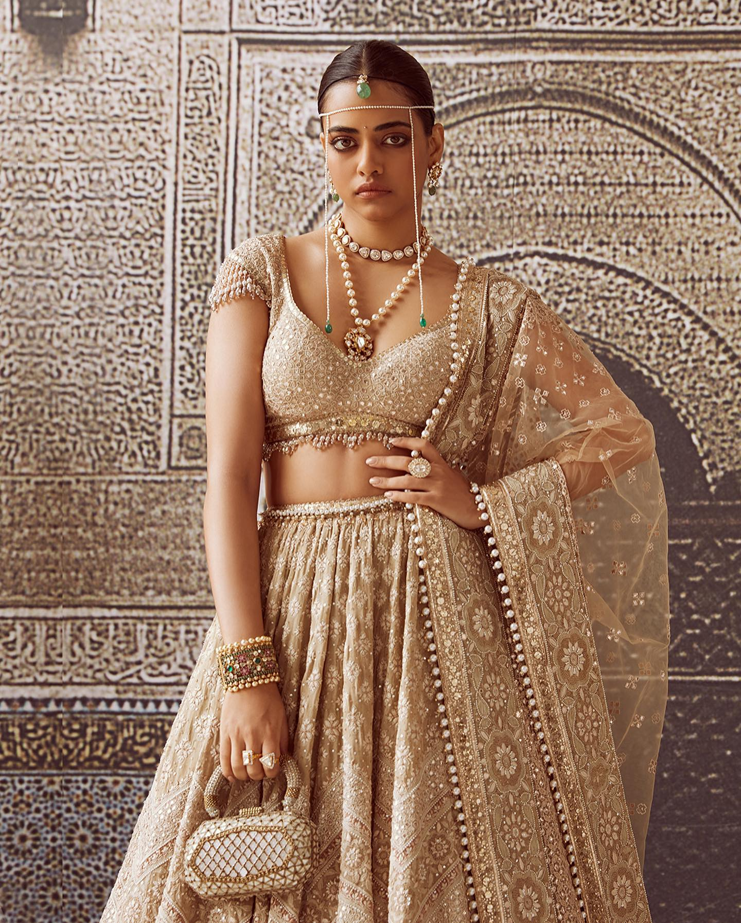 Priyadarshini is wearing 16 kalis chikankari  lehenga made in a muted colour palette of ivory punctuated with shades of ecru dusty rose  and jade. It comes with a matching blouse and tulle dupatta embellished with pearls. 2021-09-02