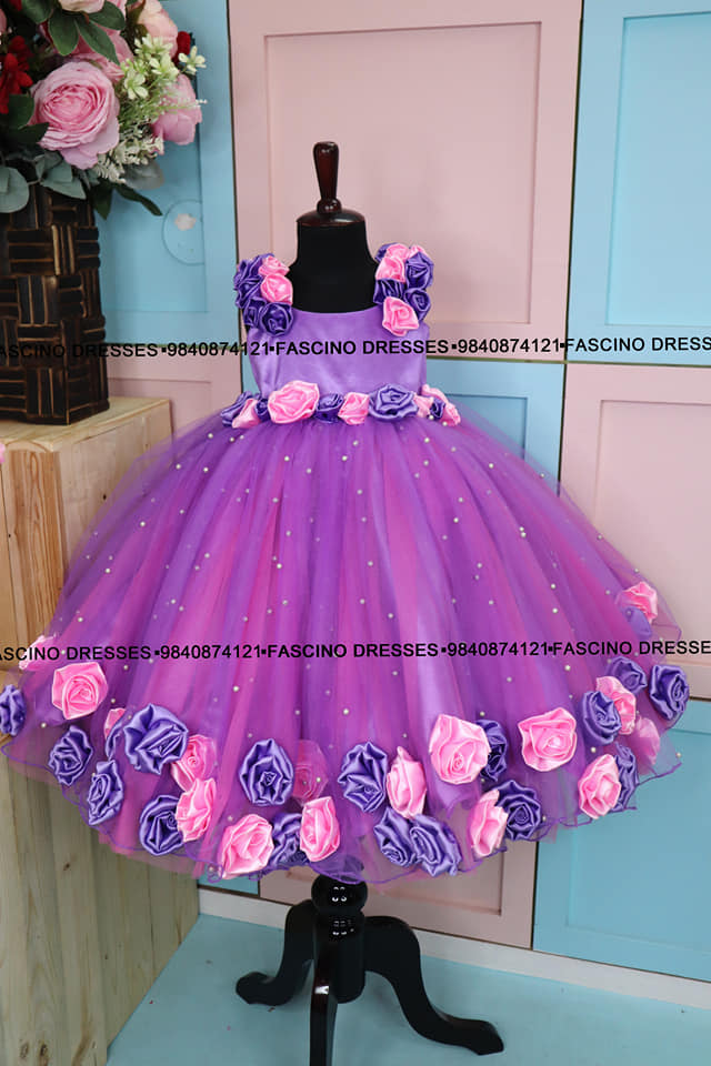 A classy lavander with pink mom and daughter combo . handcrafted bodice for mom embellished with beautiful flowers and baby dress with handmade roses . Wats app or inbox to order 9840874121. Can customize in any color / size . 2021-09-02