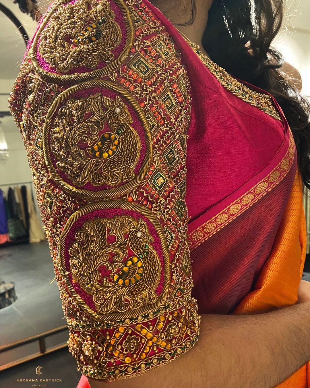 Stunning maroon bridal blouse sleeve with triple swan hand embroidery heavy zardosi work.  2021-09-02