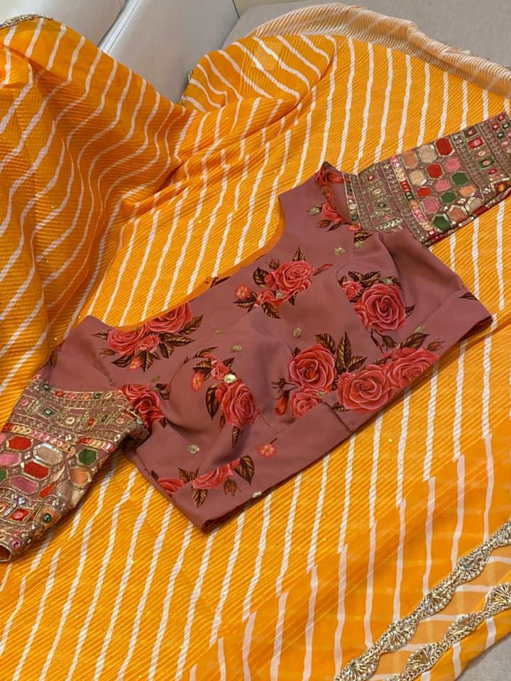 Stunning yellow color leheriya saree with floral blouse. 2021-09-03
