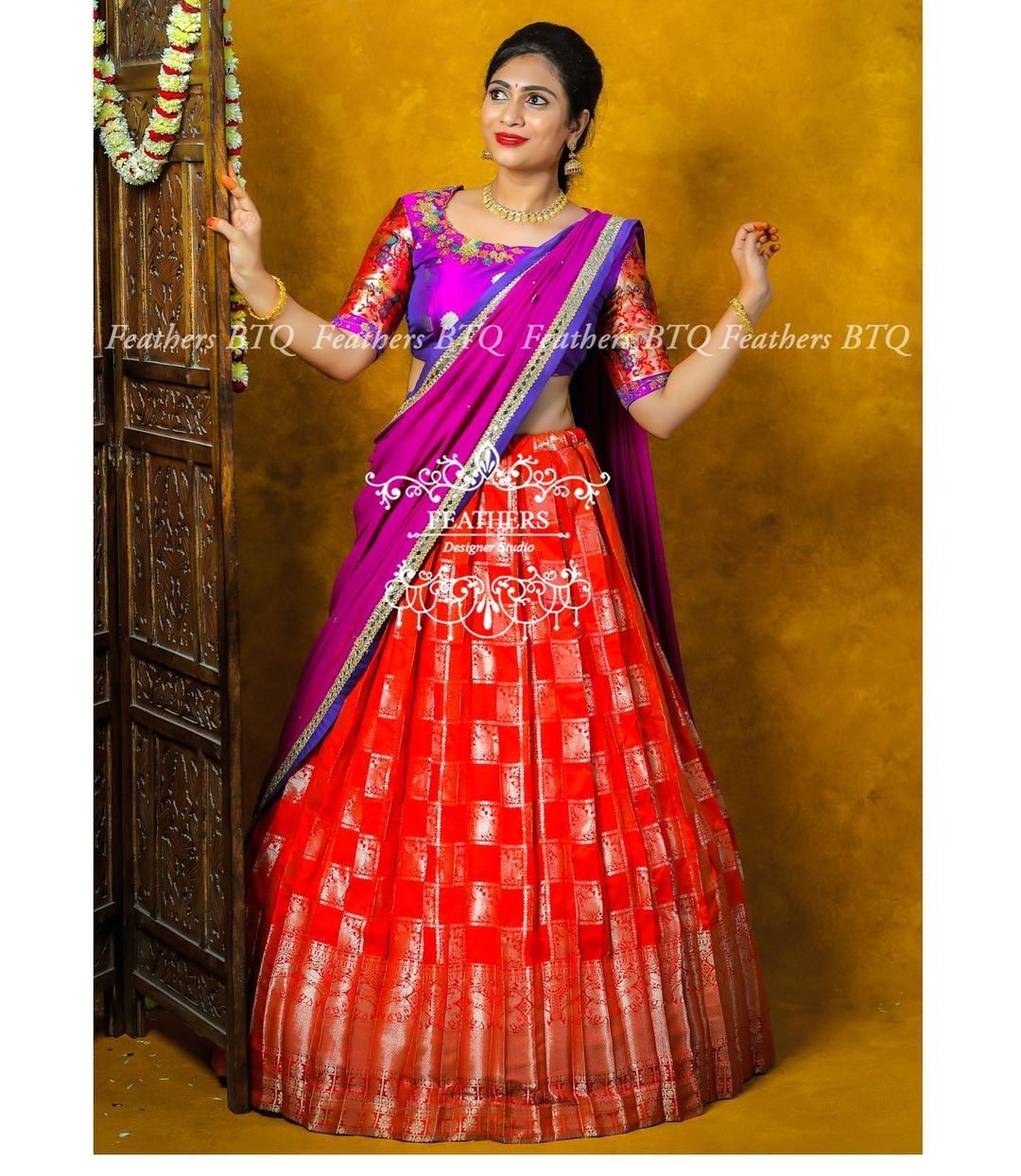 Gorgeous red pattu lehenga and purple blouse with dupatta. Blouse with embroidery work on neckline.   2021-09-03