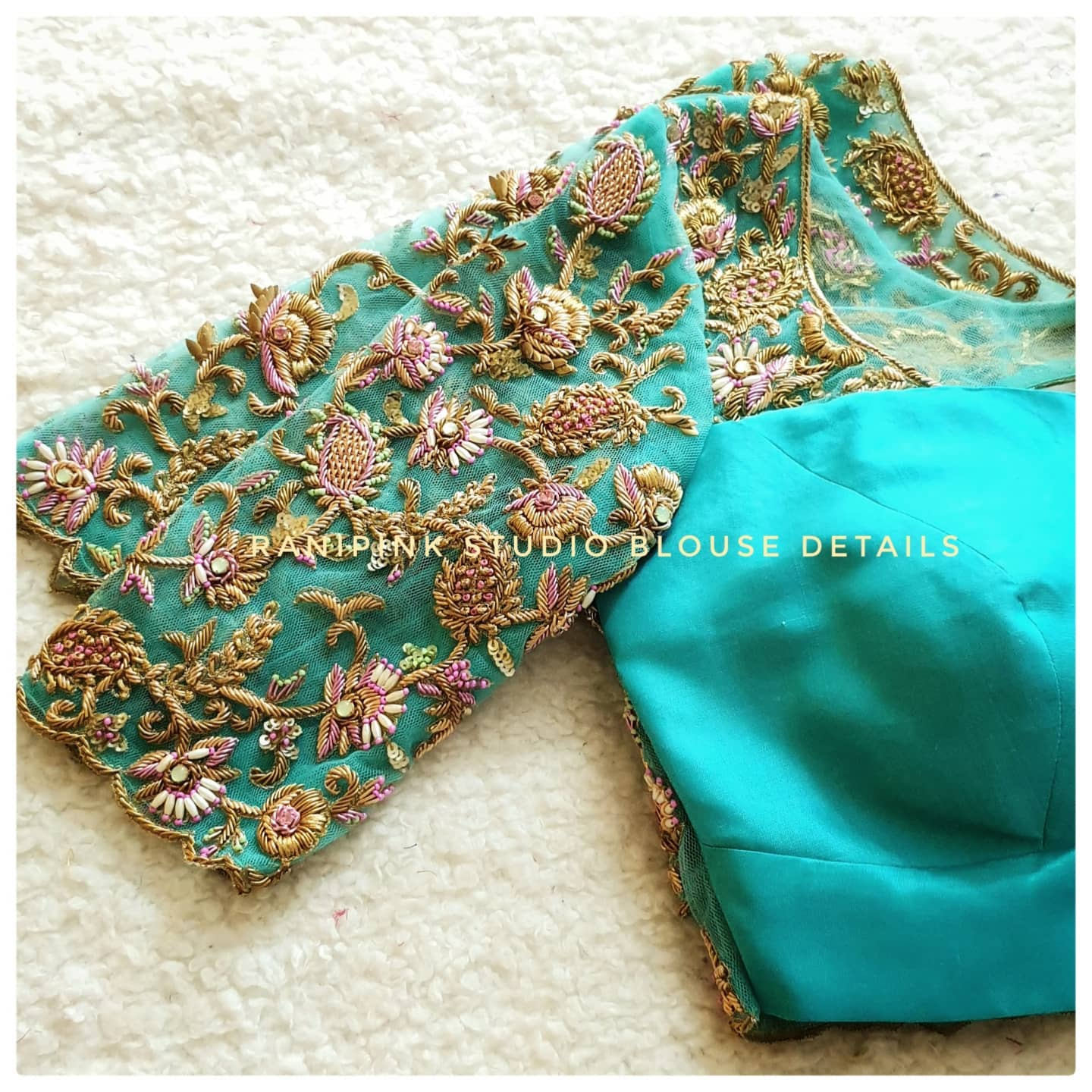 Stunning cyan color bridal blouse with floral and creeper hand embroidery gold thread and bead maggam work.  2021-09-04