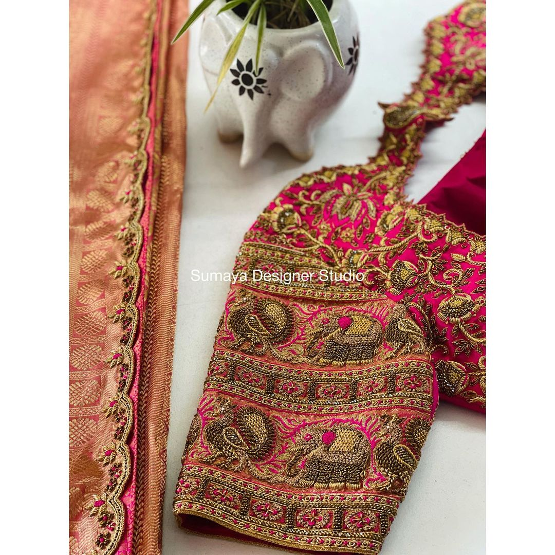 Stunning pink color bridal blouse with elephant and peacock hand embroidery zardosi work.  2021-09-04
