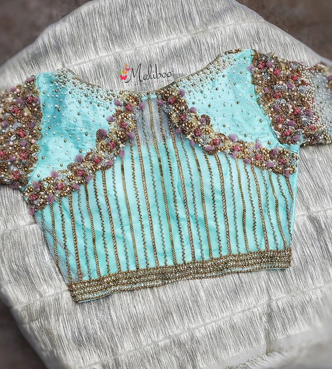 Stunning ice blue color blouse back with floral bead and thread aari work. 2021-09-04