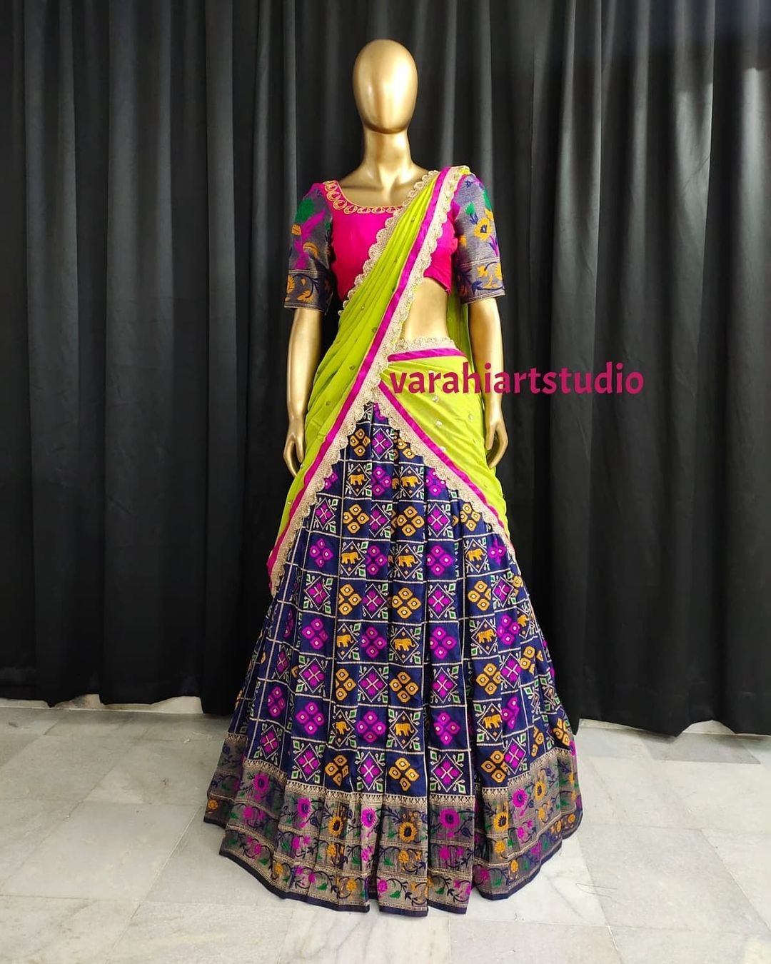 Stunning deep blue lehenga and blouse with parrot green dupatta. This outfit is Available at 9800. 2021-09-04